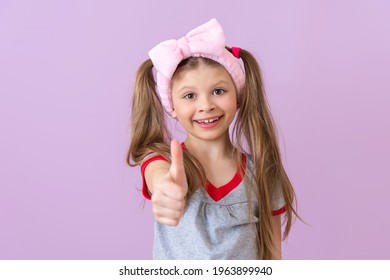 The child shows a hand gesture that everything is fine.
