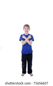 A child signs Love in American Sign Language.