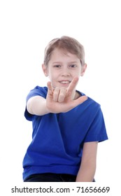 A child signs I Love You in ASL