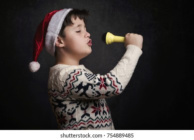 child singing Christmas carol at Christmas