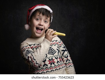 child singing Christmas carol at Christmas