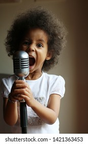 Child singing with a microphone