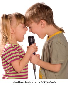 Child singing with a microphone. Funny little girl and boy isolated on white background. Beautiful caucasian model.