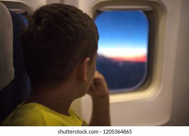 Child sitting by aircraft window