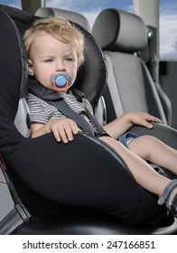 Child sitting in car safety seat