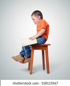 Child sitting on a chair with book