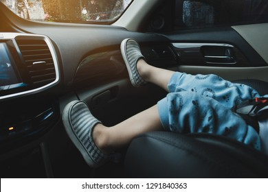 child sitting on front seat of car