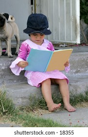 child sitting reading BLANK book