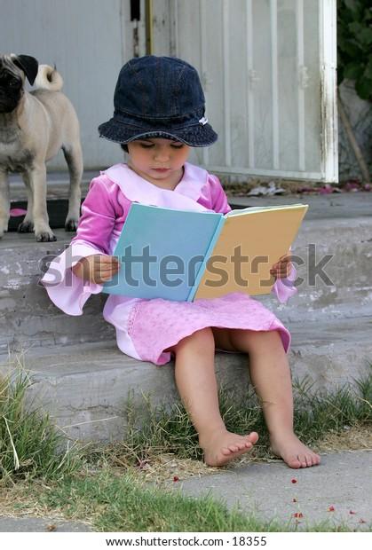 child sitting reading BLANK book