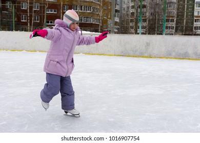 child skating in winter