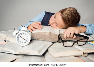Child Sleep on Books, Tired Student Kid Studying, Face Lying on Book near Alarm Clock, Children Hard Education Concept