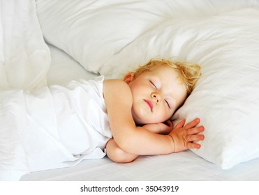 The child sleeps in bed