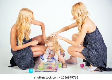 Child small boy and twins women, relatives. Mothers day, family values, trust, childhood. Love, happiness, parenting. mother and son, happiness, nephew. Happy family play with toy balls.