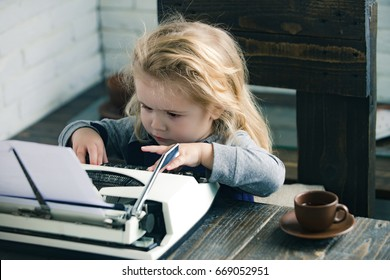 child or small businessman kid sitting at table and typing typewriter with paper and coffee cup on white brick wall background, business and new technology