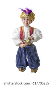 Child smilling in sultan costume with lamp isolated