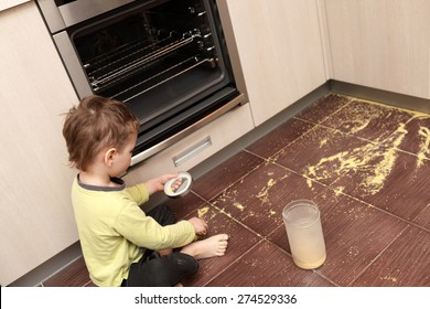 Child spilling cereal in the kitchen at home