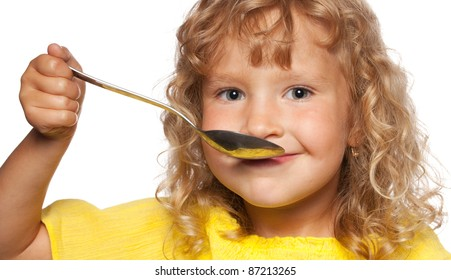 Child with spoon isolated on white