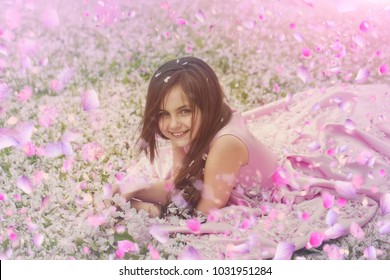 Child in spring flowers. spring flowers background.