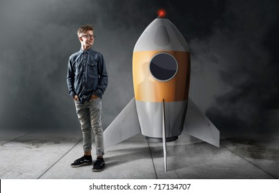 Child standing in front of a rocket