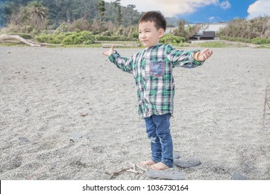 Child standing on a beach,