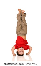 child standing on his arms, yoga