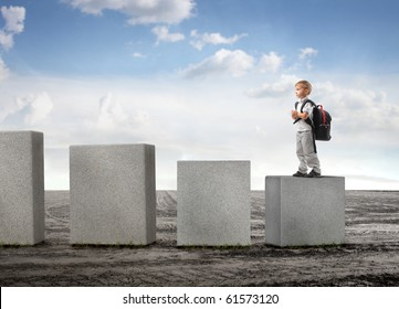 Child standing on the lowest cube on a field
