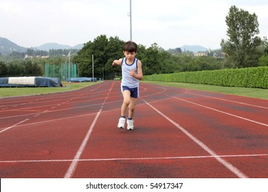 Child standing on a running track