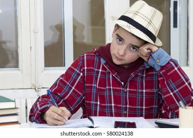 child studying in the desk of House or of the college