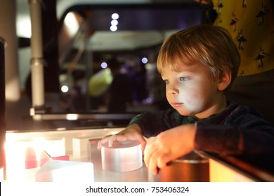 Child studying the refraction of light in lab