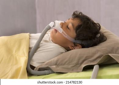 child suffering from Sleep Apnea, using a CPAP machine