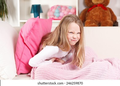 Child suffering from stomach ache