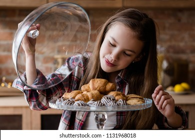 child sugar addiction. unhealthy eating habits. confectionery and puff pastry overeating. little girl is a sweet tooth and drooling over croissants and chocolate sweets