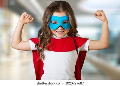 Child superhero kid against