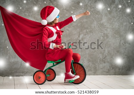 Child superhero. Kid playing at home. Christmas Xmas Winter Holiday Concept