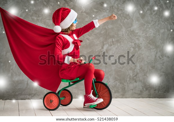 Child superhero. Kid playing at home. Christmas Xmas Winter Holiday Concept