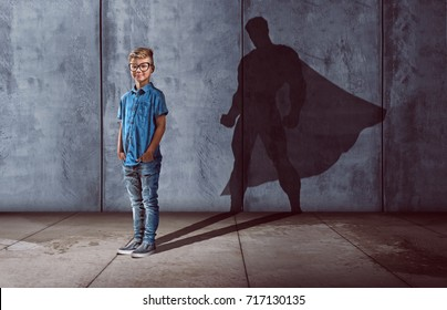 Child with superhero shadow