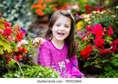child surrounded by flowers