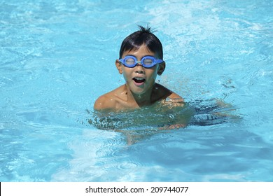 The Child Swimming In The Pool