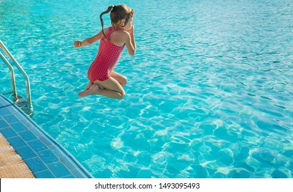 the child swims and dives in the pool. Selective focus.