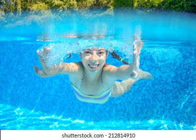 Child swims in swimming pool, playing and having fun, underwater and above view, kids sport and vacation