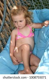 child in a swimsuit on a blue towel