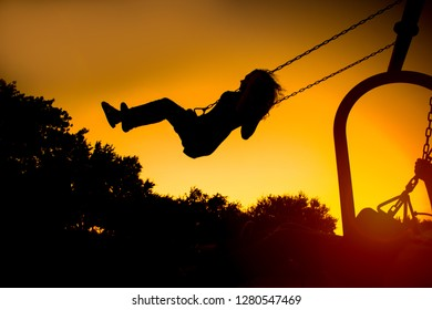 child swinging high