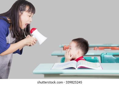 Child and teacher screaming  in the classroom