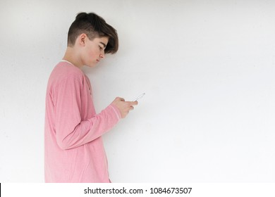 child or teenager on the wall with mobile phone