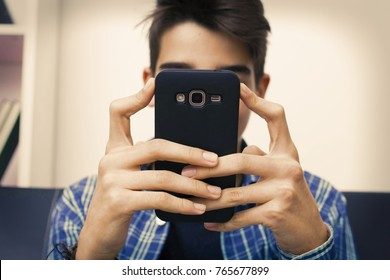 child, teenager or preteen with mobile phone at home