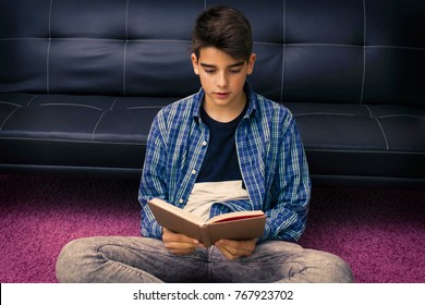 child, teenager or preteen reading or studying at home