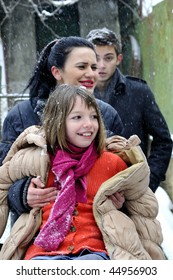 child and teenagers having fun in winter