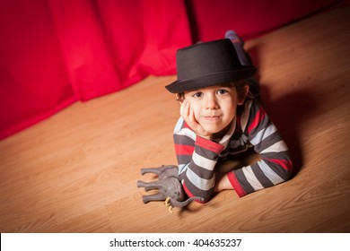 child in the theater on red background