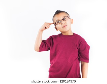 Child in thought Isolated on white background. Boy wearing glasses with a big Idea
