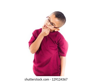 Child in thought Isolated in white background. Boy wearing glasses